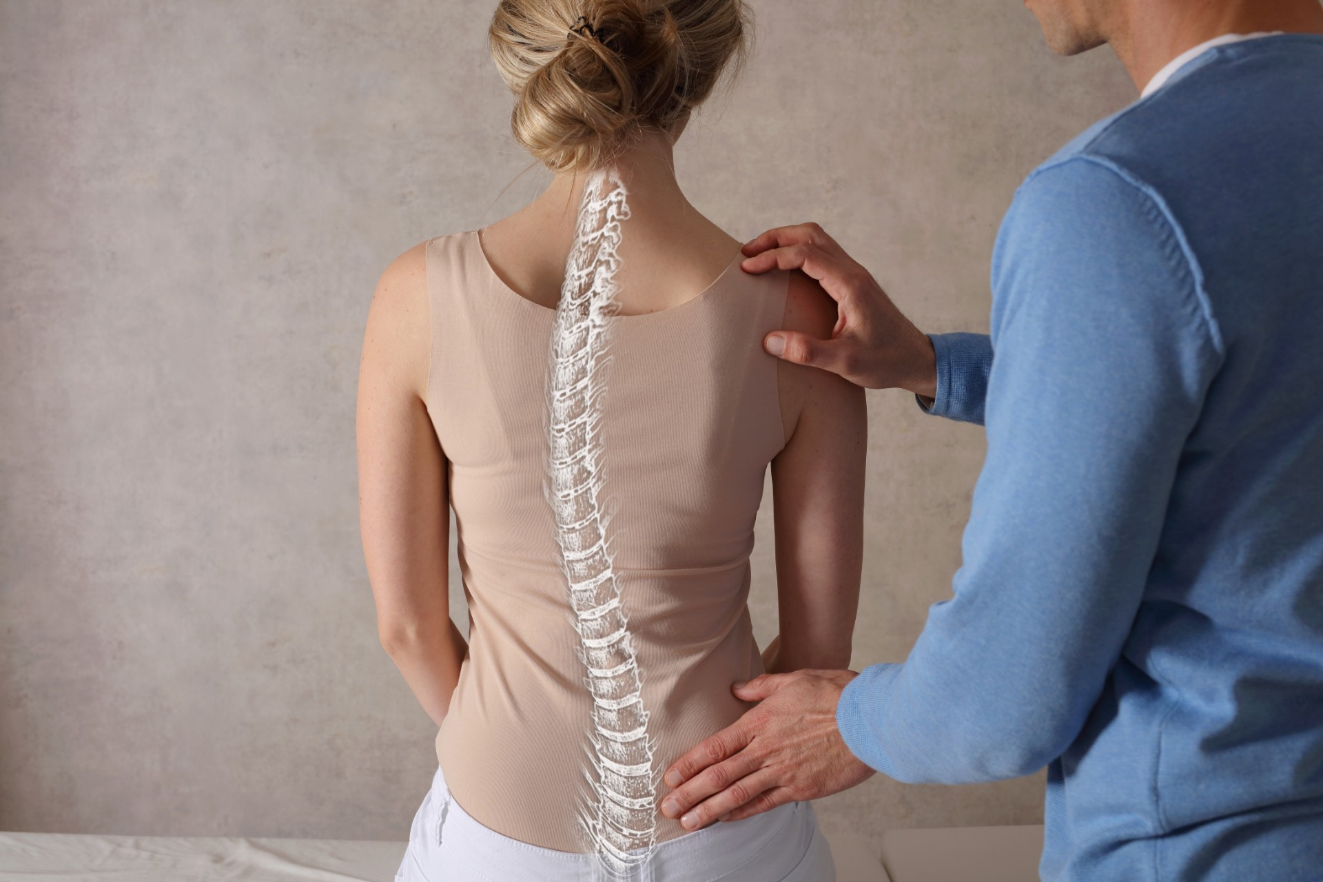 Orthopedic surgeon treating patient
