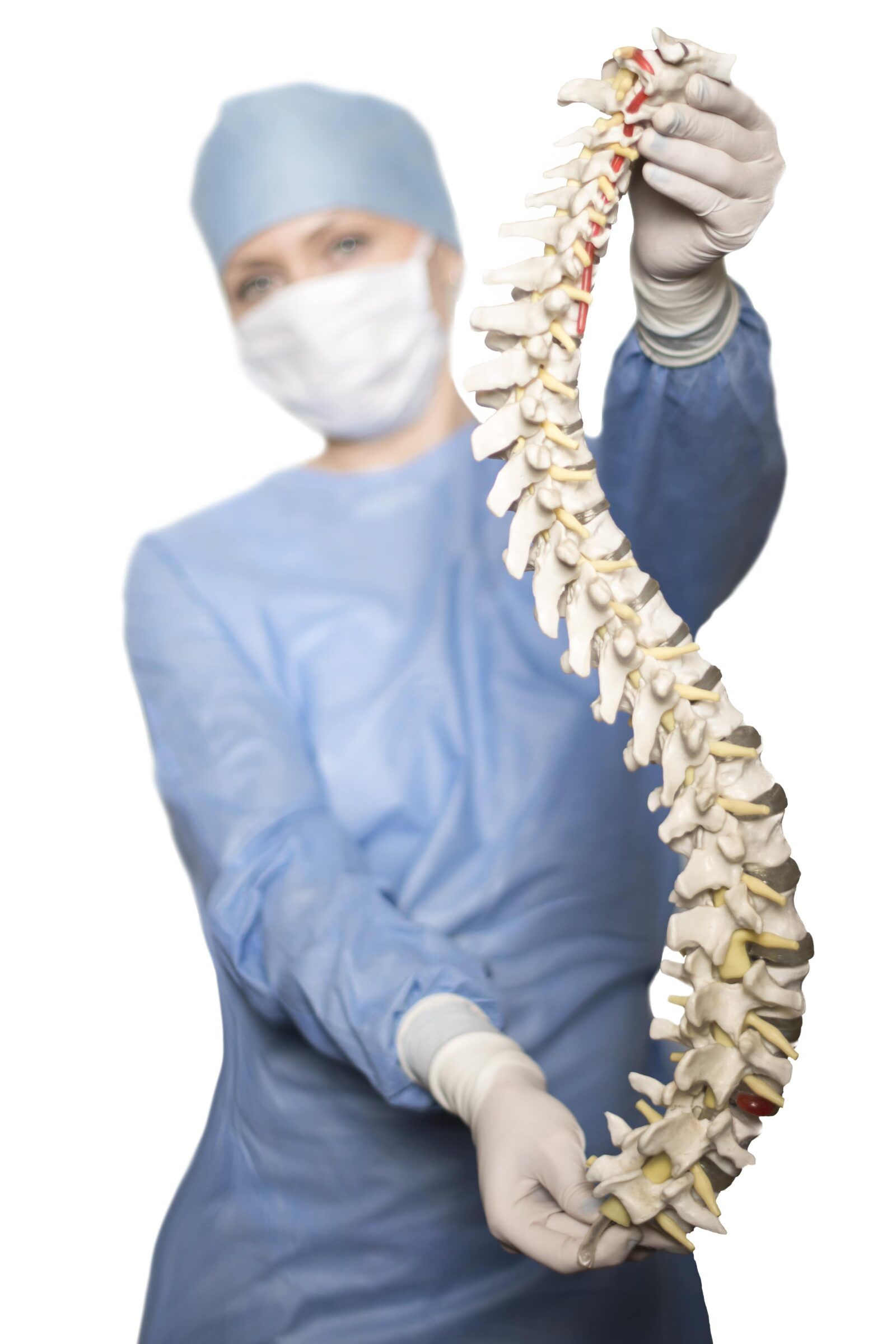 spinal surgeon holding model of the spine