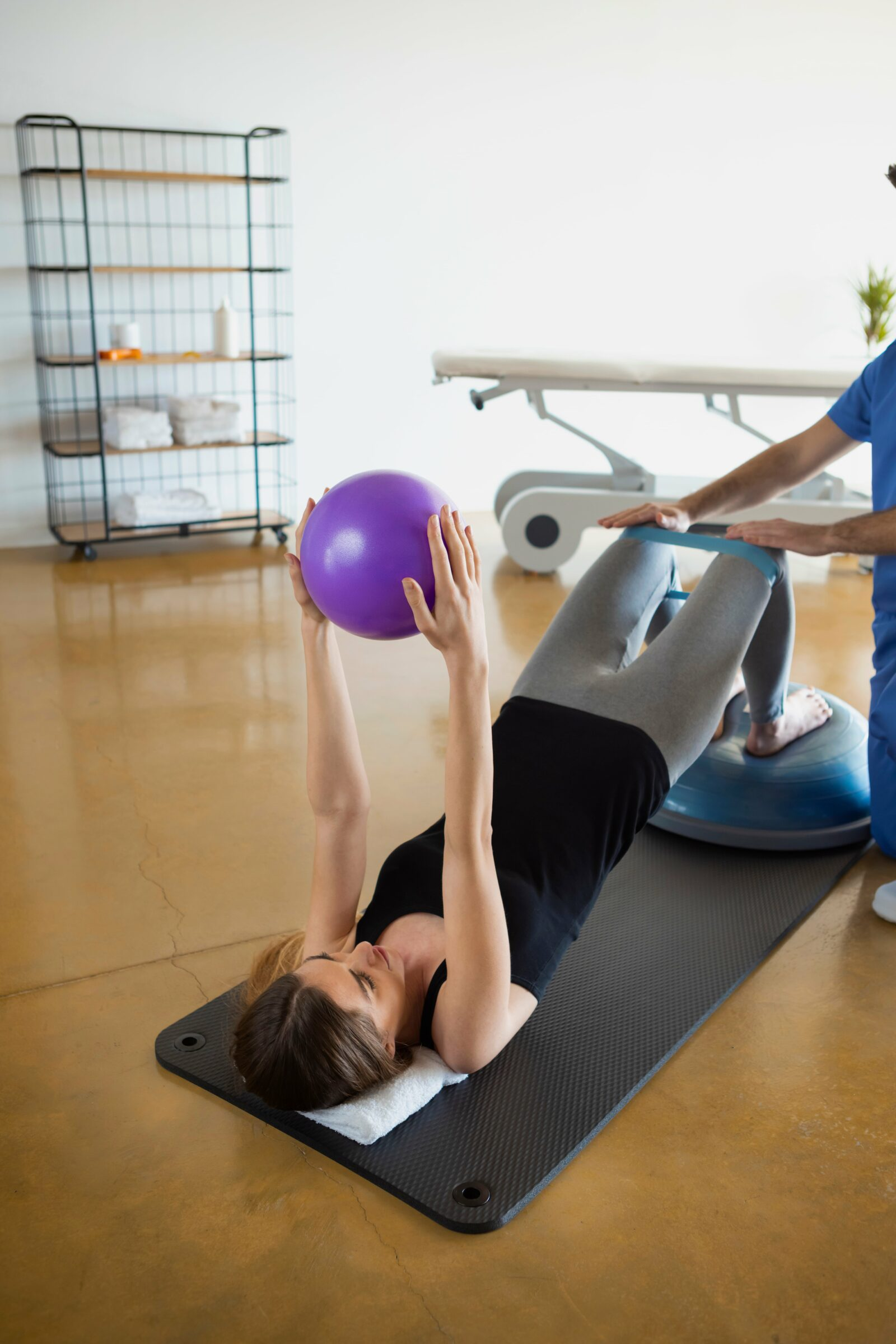 woman working on core exercises with her physical therapist