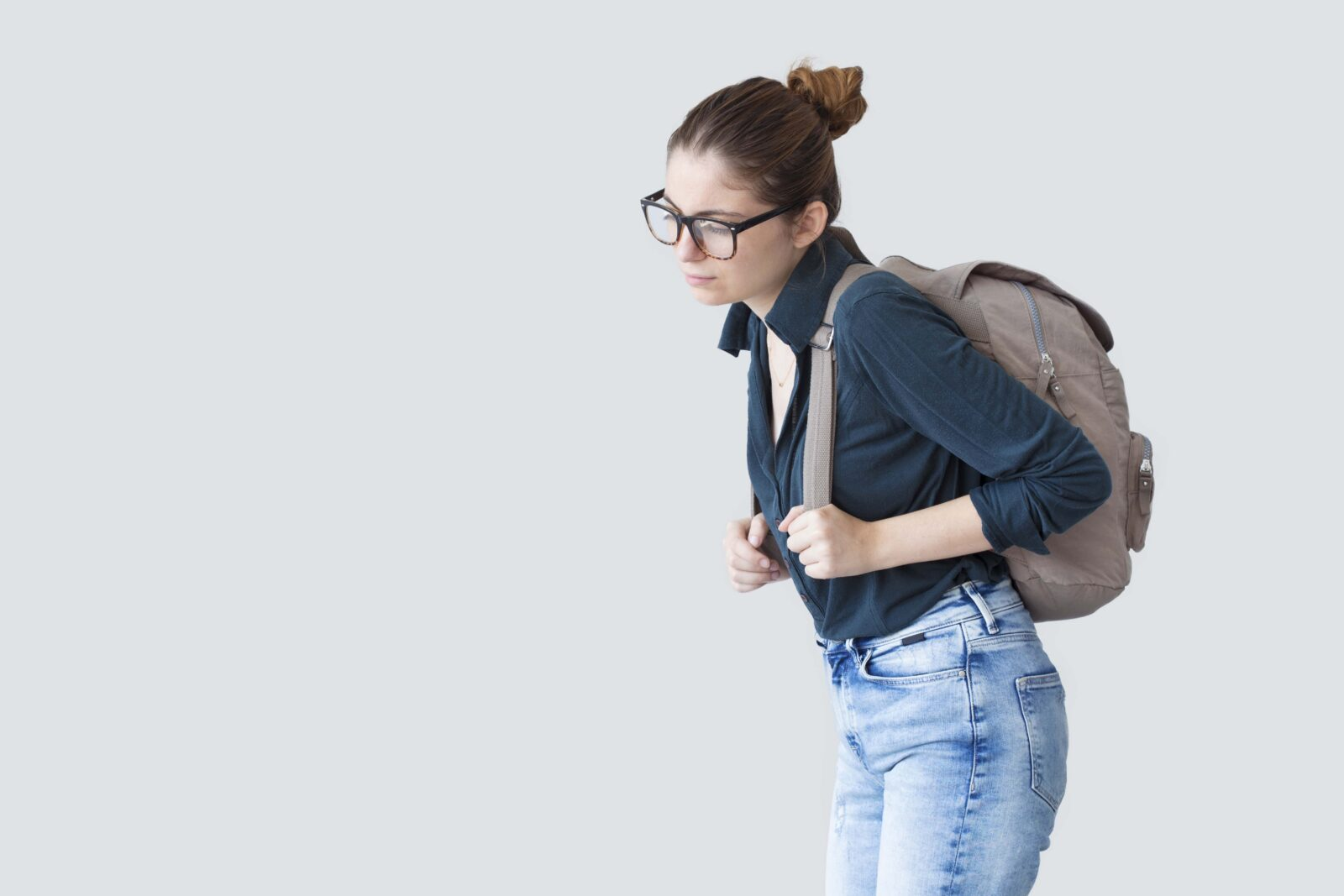 woman walking with large backpack