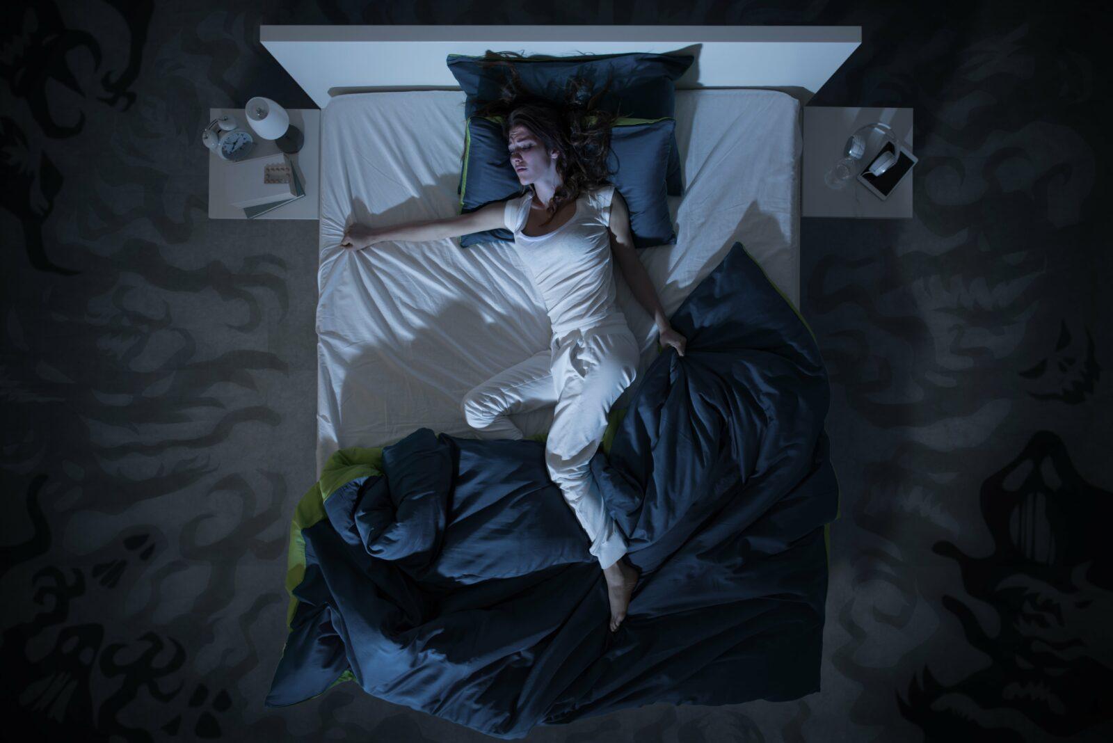 woman restlessly sleeping